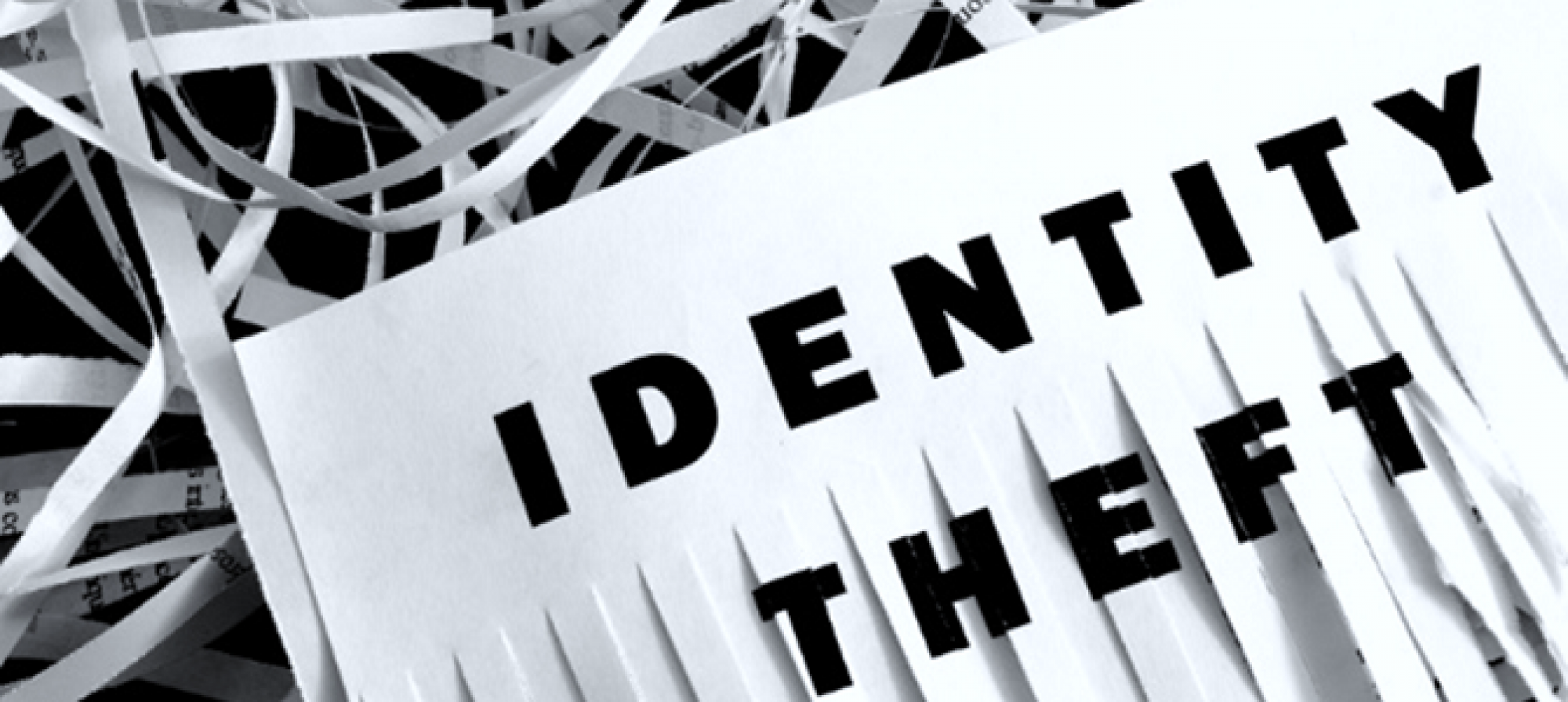 A half shredded piece of paper with the words Identity theft on it
